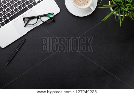 Office leather desk workplace table with laptop, coffee cup and plant. Top view with copy space