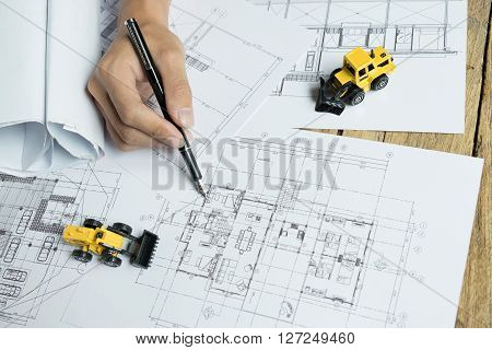 Blueprints Hardhat or safty helmet Pen in architecture office retro style