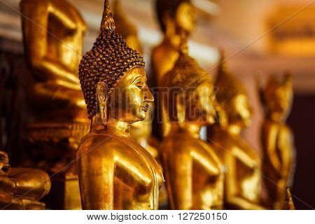 Golden Buddha statues in buddhist temple Wat Saket (The Golden Mount), Bangkok, Thailand