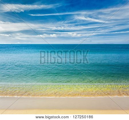Resort beach holidays concept - tropical beach with clear water, wave surging on yellow sand and beautiful sky cloudscape, Sihanoukville,  Cambodia