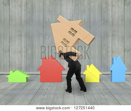 Businessman Carrying Wooden House On His Back