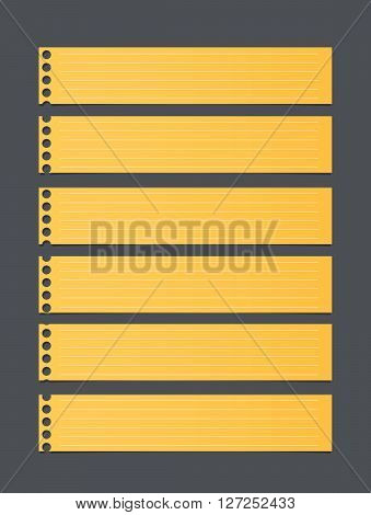 Pieces of cut yellow lined notebook paper, banners are stuck on dark gray background.