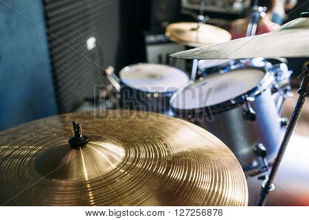 Modern drum set prepared for playing background top view. Flat lay professional drum kit  before a live concert. Drummer, music band, night show, sound recording concept
