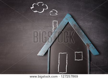 House shape on a blackboard new home concept