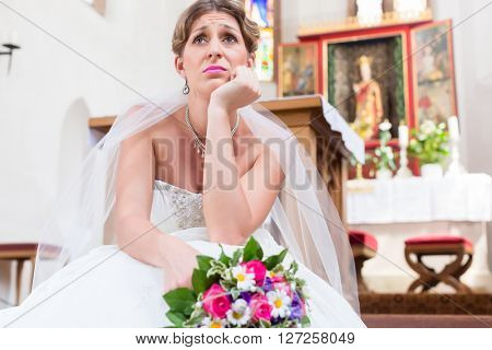 Bride waiting alone for wedding being frustrated