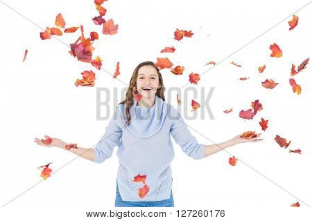 Happy woman throwing leaves on white background