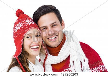 Happy couple with winter clothes embracing head to head on white background