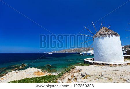 White greek windmills overlooking Little Venice popular tourist destination at traditional village on Mykonos Island, Greece, Europe