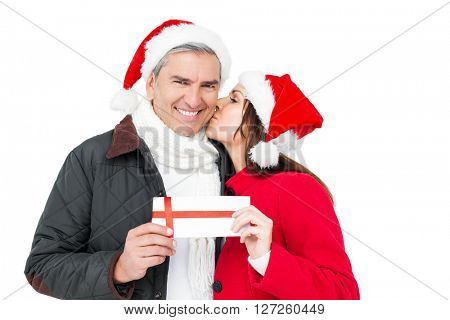 Festive couple holding christmas gift and kissing on white screen