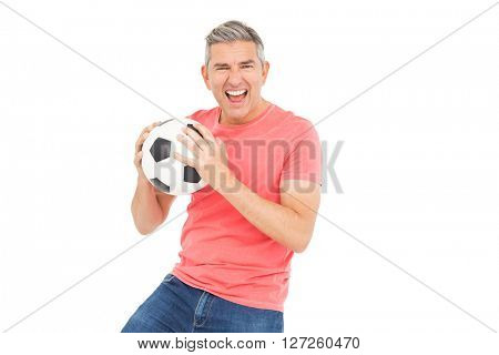 Happy man holding a soccer ball on white background