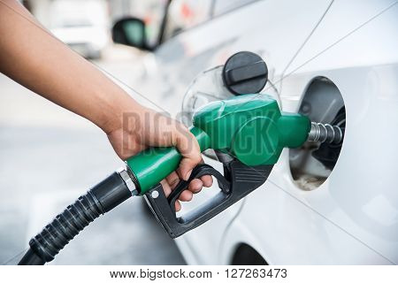 Handle Fuel Nozzle To Refuel The Car.