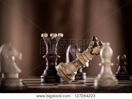 Black chess king crashes white chess king. Competition concept.