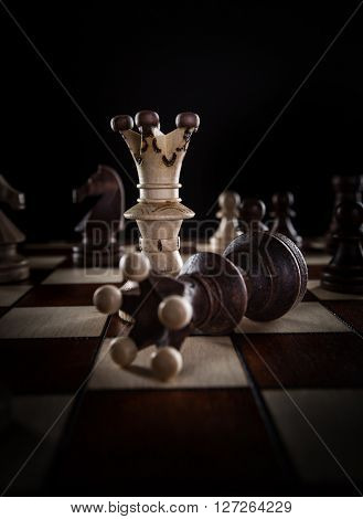 White chess king crashes black chess king. Competition concept.
