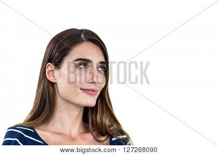 Close-up of smiling young woman standing on white background