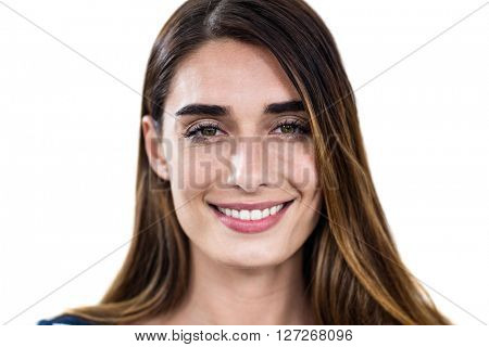 Close-up portrait of smiling young woman standing on white background