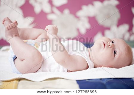 Close up portrait of a newborn baby boy at home