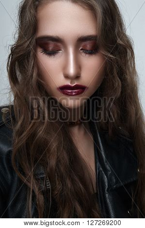 Fashion beauty rock brunette Girl with closed Eyes and black leather Jacket