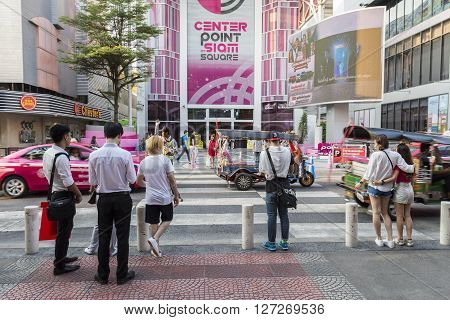 BANGKOK THAILAND - APR 10 : unidentified people wait for walk across crosswalk near Digital Gateway at siam square on april 10 2016 thailand. siam square is famous shopping place of Bangkok