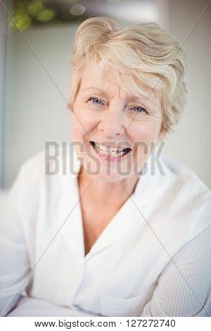 Close-up of smiling senior woman at home