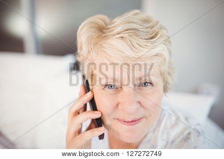Close-up portrait of senior woman talking on phone