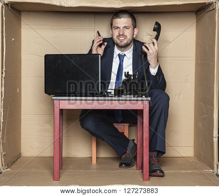 Businessman Leading Two Calls At The Same Time, Box Office