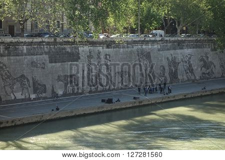 ROME ITALY - APRIL 19 2016: South African artist William Kentridge unveils Triumphs and Laments a 550-meter (1804 feet) frieze along the embankment of Tiber River