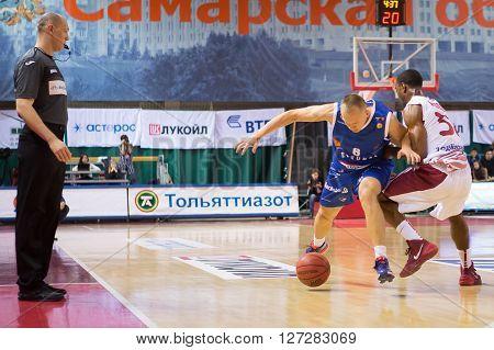 Bc Neptunas Guard Mindaugas Girdziunas (8) Fights For A Loose Ball With Bc Krasnye Krylia Guard Aaro