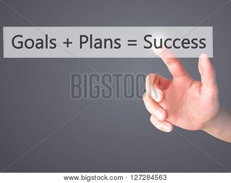 Goals  Plans  Success - Hand Pressing A Button On Blurred Background Concept On Visual Screen.