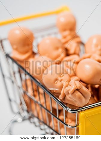 embryo model. fetus symbolizing genetic engineering, surrogate m