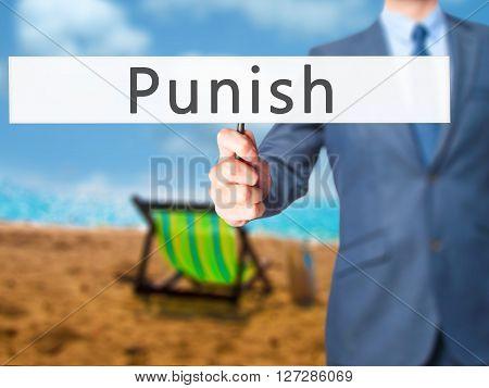 Punish - Businessman Hand Holding Sign