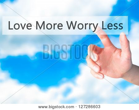 Love More Worry Less - Hand Pressing A Button On Blurred Background Concept On Visual Screen.