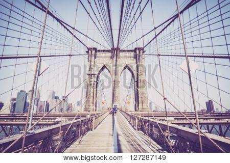 Vintage Toned Blurred Photo Of The Brooklyn Bridge.