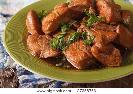 Delicious Filipino Food: Adobo Chicken With Herbs Close-up. Horizontal