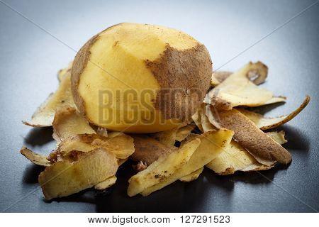 Raw Peeled Potatoes And Potato Peelings