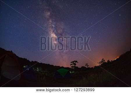 Silhouette Of Tree With Tent And Milky Way At Phu Hin Rong Kla National Park,phitsanulok Thailand. L