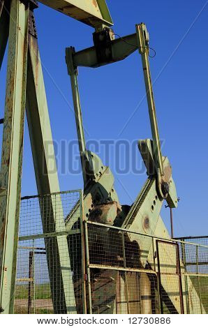 An oil well pumping unit on a California lease -- counterweight closeup poster