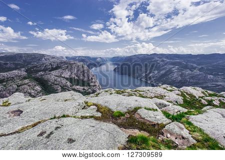 Trekking in Norwegian fjords - view over Lysefjord from a cliff