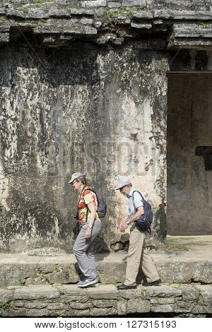 Tourists At Palenque Mayan City Ruins In Mexico