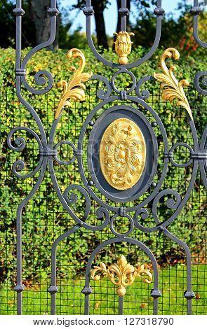 KYIV, UKRAINE - SEPTEMBER 14, 2014: Fence of former private residence of ex-president Yanukovich (Mezhyhirya) now open to the public, Kyiv region, Ukraine