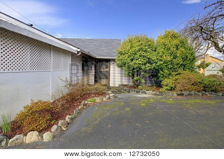 Small Old House With Black Front Door And Driveway