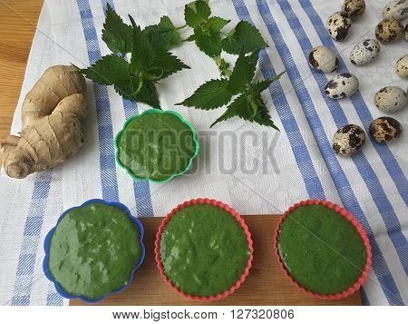 Cooking nettles ginger muffins, organic food with wild plants and quail eggs