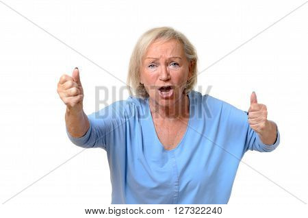 Emotional Senior Woman With Clenched Fists