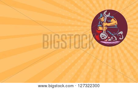 Business card showing illustration of a mechanic holding giant wrench unscrewing set inside circle on isolated background done in retro woodcut style.
