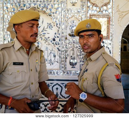 Delhi, India - September 27, 2014: two indian policemen in uniform close up image at Amber Fort on the outskirts of Jaipur in India