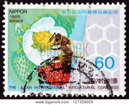 JAPAN - CIRCA 1985: a stamp printed in the Japan shows Honeybee and Strawberry Plants 30th International Apicultural Congress Nagoya circa 1985