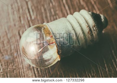 an old bulb on a wooden background