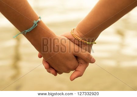Happy Children Friends Hold Hands In Summertime