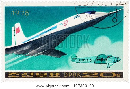 MOSCOW RUSSIA - APRIL 09 2016: A stamp printed in DPRK (North Korea) shows Russian supersonic passenger aircraft Tu 144 and old airplane series