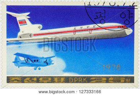 MOSCOW RUSSIA - APRIL 10 2016: A stamp printed in DPRK (North Korea) shows Soviet passenger aircraft Tupolev Tu-154 and old airplane series