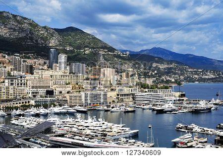 LA CONDAMINE, MONACO - MAY 16: Aerial view of the Port Hercules on May 16, 2015 in La Condamine, Monaco, during the preparations for the 73 Monaco Grand Prix, and Monte Carlo in the background